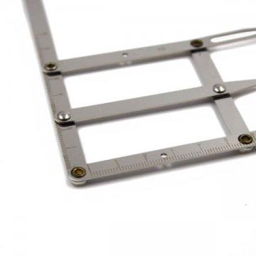 metalowy cyrkiel dozłotego podziału symetrii brwi